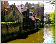 Old Bruges and canal (jackfre2) Tags: flowers trees light water boat canal shadows belgium violet tourists roofs tiles bruges guide visitors woodenhouse veryold flanders thegalaxy