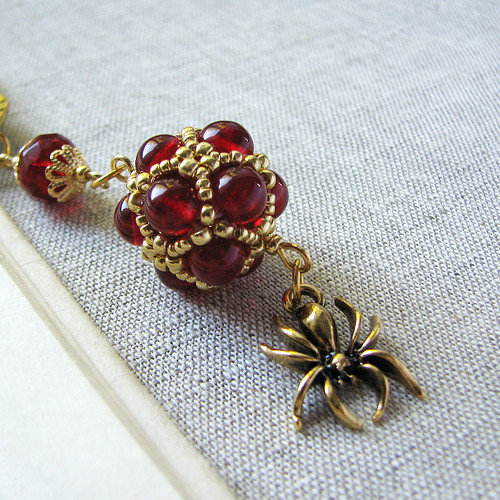 antique golden handmade bookmark with red wine beadwoven bead and a spider charm