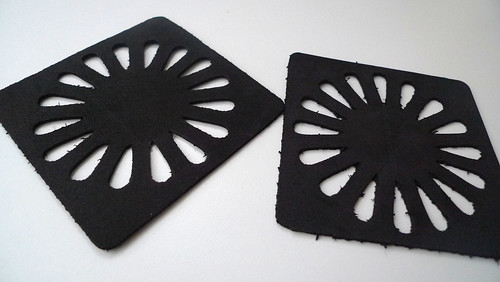 black coasters with flower