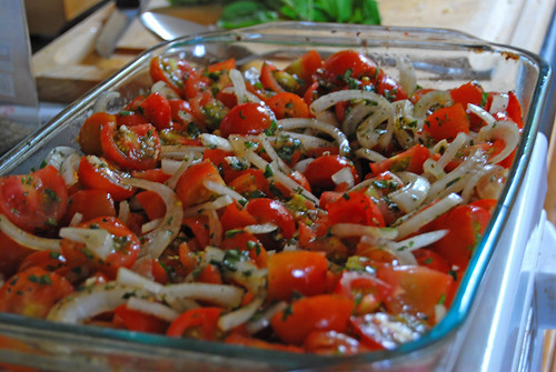 Local herbs, sweet onions, tomatoes, sea salt, & macadamia nut oil about to be oven roasted.