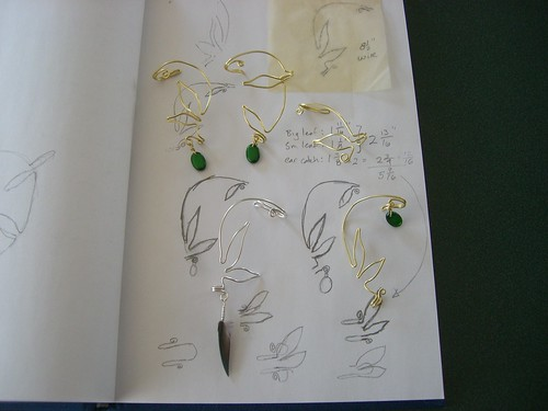 Several feather/leaf ear cuffs, all slightly different