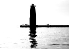 Frankfort Lighthouse in silhouette (Katy Silberger) Tags: silhouette reflections blackwhite lakemichigan reflexions benziecounty nikond60 frankfortmi frankfortlighthouse betsielake