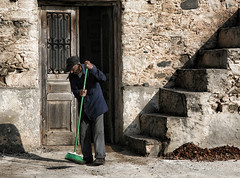 old man sweeping