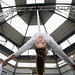 Aerialist Jennifer Paterson from 'Spokes' launches Merchant City Festival at The Briggait suspended on silk 2 Credit - Iain McLean