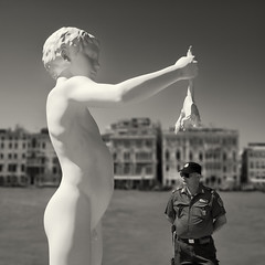there are two sides to every story (urchino) Tags: venice bw italy sculpture square policeman lumixgf1 20mmpancake