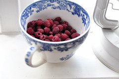 raspberries. (Nadja Endler and the Food) Tags: white cup sweet raspberry lantern windowsill raspberries flowerpattern shabbychic blueflowerpattern