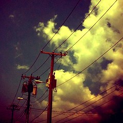 on the wire (dustychenille) Tags: summer sky clouds alley downtown industrial phone telephone richmond line cables wires poles waste telephonepoles 2010 lineman