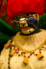 global village mannequin (Studiobaker) Tags: winter red white snow black cold mannequin hat minnesota yellow necklace beads store sweater scary december village pacific native 2006 totem dec islander spooky storefront maori mn duluth global alaskan hells studiobaker