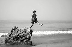 Ministry of silly walks (Maddie Joyce) Tags: ocean santa sea bw white black silly bus beach boyfriend water d50 50mm maddie jump sand nikon funny rocks waves walk magic barbara joyce wwwthemagicbuscollectivecom