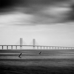 Taking the slow way home (c e d e r) Tags: ocean longexposure bridge sea sky blackandwhite bw white seascape black skne europe foto sweden daytime malm scania ceder resund resundsbron ndfilter skane nd110 resundbridge flickriver aperture3 cederfoto 10stopgreyfilter daytimeexposure
