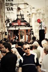Trolley and Stilts on a Crowded Street (danleyc) Tags: street city trolley citylife stilts crowded challengeyouwinner flickrchallengegroup flickrchallengewinner