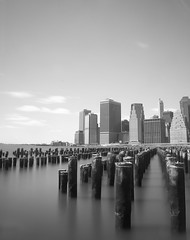 (Vitaliy P.) Tags: park new york city nyc longexposure light sun white black water glass skyline brooklyn clouds buildings 1 pier wooden still nikon long exposure downtown day shadows angle flat natural time manhattan welding columns wide 11 dirty shade gothamist sensor d80 18135mm nikond80challenge vitaliyp gettysubmitted
