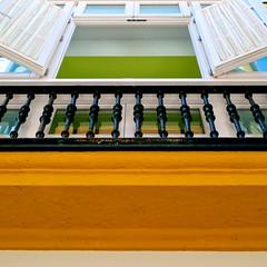 Balcony - Cadiz, Spain (L F Ramos-Reyes) Tags: leica wood blue orange white black green window glass colors facade contrast spain europe shadows framed balcony highlights cadiz ironwork lionfrr theauthorsplaza