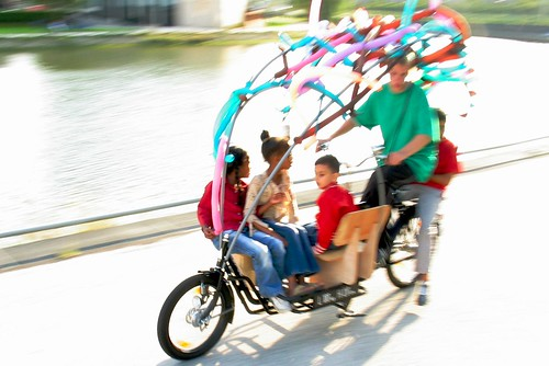 five kids on a long john bike