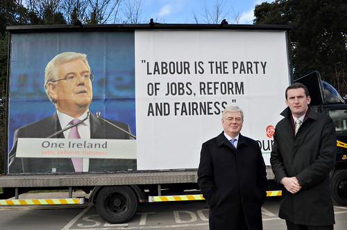 Eamon Gilmore and Aodhain ORiordain with mobile billboard