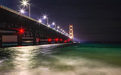 Mackinac Bridge at Night (T P Mann Photography) Tags: mackinac bridge huron michigan lake water waves shore beach long exposure night light lights reflections sea seascape bay color aqua blue stars canon 6d eos dslr red structure architecture bursts landscape rural canonflickraward