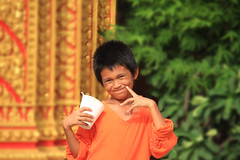 Smile (Chandana Witharanage) Tags: cambodia phnompenh southeastasia child children smile people asia culture face naturallight outdoor portrait streetphotography happiness fun tradition eyes orange beautifulboy