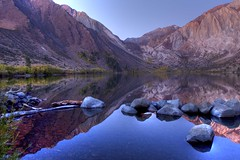 One lake that is worth getting up real early for! (Maureen Bond) Tags: ca trees sky sun lake snow mountains cold sunrise mirror morninglight rocks colorful fallcolor earlymorning boulders stillwater refelction easternsierra convictlake worthit utatafeature maureenbond