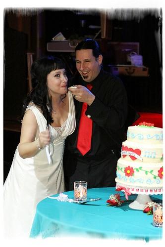 Cutting the cake! Yum! Photo by Michael Spleet
