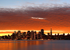 Goodbye, San Francisco! (Rob Kroenert) Tags: world sanfrancisco california ca sunset orange holiday skyline clouds island lights bay san francisco treasure pyramid embarcadero around goodbye transamerica 2007