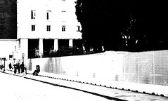 (Bert08) Tags: street city trees windows light people blackandwhite bw italy rome bus contrast fence buildings day shadows sidewalk stop walls