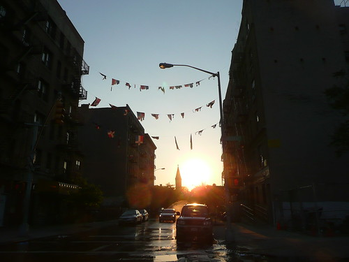 Puerto Rican flags. Sun going down.