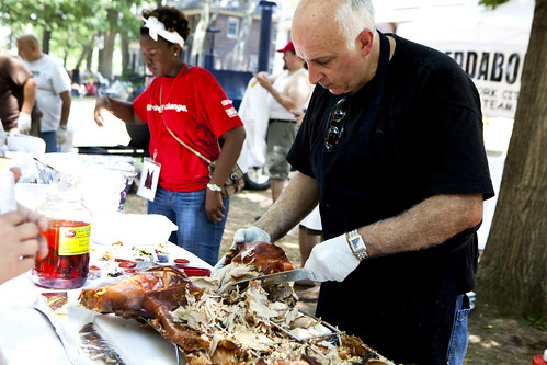 Joe Mizrahi's working on the La Caja China Roasted Pig