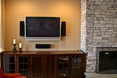 "Home Theater/Whole House A/V - 50"" plasma, equipment in cabinet, surround system & custom remote"