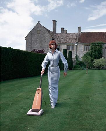 Geof Kern, Untitled model vacuuming lawn, 1995