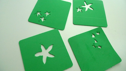 green coasters with flowers
