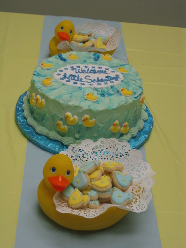 the baby blue-colored cake's flavor was white chocolate with raspberry ...