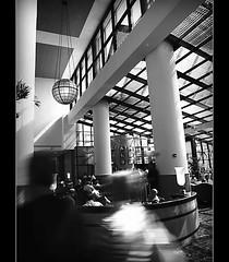 Untitled (aveinfinite) Tags: light people bw white motion black lines hotel candid system 43rd ghosting orlandoflorida randomscene olympuse510 evolt510 zuiko1442mmkitlens