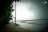 Move along! (Shimul Kibria) Tags: punt punting bamboo green water river rain raining road path sky cloud clouds tree man kanchkura uttara dhaka bangladesh shimulkibria canon photography summer canoneos400ddigital canonefs1855mm3556 flickraward