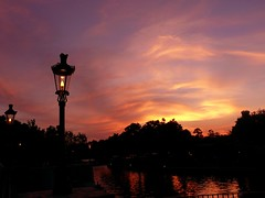 Sunset (Tasmin_Bahia) Tags: blue light sunset shadow red sky orange usa sun holiday black beautiful sunshine yellow clouds america orlando pretty shadows florida warmth sunny lampost magical whispy