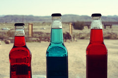 Out West (webmissy) Tags: blue red west cowboys highway desert bottles nevada trucks