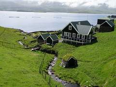 Blingurin  B  Froba - The Old Part of Frodba with the Grave Yard and a Water Mill - Faroe Islands (Eileen Sand) Tags: sea summer seascape nature cemetery graveyard fog landscape island islands europa europe july fjord juli faroeislands watermill myndir faroe 2010 islandhopping faroes froyar kirkjugarur frerne faroese suuroy foroyar hillfog suduroy froba placesyouvisit frodba aliringar trongisvgsfjrur frodeb eileensand tjaldavksholmur salmonfarmrings frobur b bfroba vatnmilla