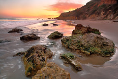 El Matador State Beach, Ca - Land of the marching dirt elephant ( Pacheco) Tags: ocean california longexposure light sunset cloud seascape seaweed green reflections fire waves skies pacific malibu pacificocean canon5d redsky southerncalifornia dpp fireinthesky seagul pacheco oceansunset elmatador mizzy mossonrocks malibucalifornia oceanphotography linesandshapes canon1740mm digitalphotoprofessional elmatadorstatebeach cokinfilters malibusunset californialandscapes stormywaves oceanlandscape californiastatebeaches capturenx2 pachecophotography matthewpachecophotography reflectionsinsand