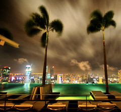 Night Infinity Pool - Singapore (` Toshio ') Tags: city sunset storm water pool architecture night clouds buildings singapore asia downtown glow cityscape nightshot cloudy casino swimmingpool palmtrees cbd hdr highdynamicrange infinitypool centralbusinessdistrict toshio marinasands