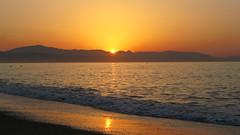 Sunrise at Playa el Bajondillo (tarmo888) Tags: beach sunrise spain europe playa andalucia rand torremolinos canonpowershot browncolor puhkus vacationtravel beachsunrise  yellowcolor photoimage tx1 sooc kollane pikesetus pruun gisteqphototrackr geosetter year2010 koidik geotaggedphoto gettyvacation2010 foto