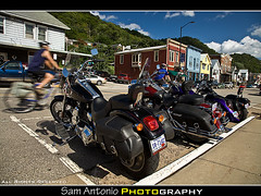 Cruising Along in Alma, Wisconsin (Sam Antonio Photography) Tags: street camera travel summer usa history water bike wisconsin america canon river mississippi photography mainstreet flickr cyclist unitedstates lock dam alma