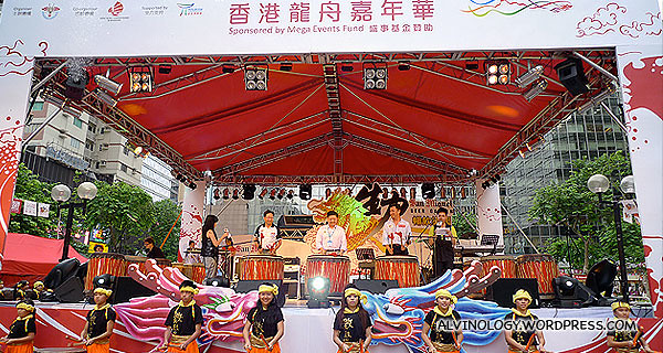 The VIPs beating on the drums to announce the opening of the dragon boat carnival