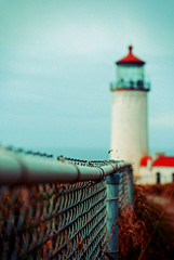 Cape Disappointment (ewitsoe) Tags: park summer vacation cliff lighthouse building beautiful fence 50mm washington nikon tour view cloudy structure chain wa cape washingtonstate viewpoint capedisappointment utatafeature