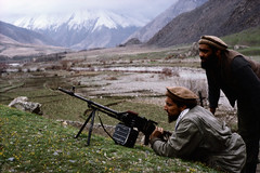 AAEC001172 (Memories of Massoud) Tags: 2 people afghanistan men asia gun asians military muslim beards valley weapon males prominentpersons leader facialhair reclining adults centralasia machinegun bodyguard guerrilla lyingdown inspecting afghans examining militarypersonnel militaryofficer governmentofficial mujahideen politicalleader centralasians militaryleader takharprovince ahmedshahmassoud pakols farkharvalley