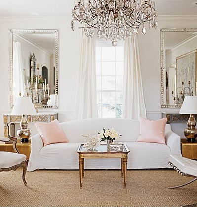 pale pink white sofa and chandelier