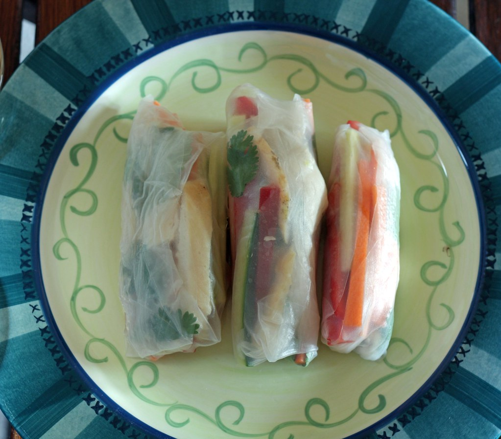 plate of summer rolls and sauces