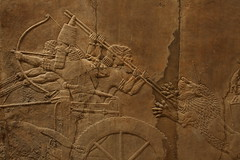 The Royal Lion Hunt (tik_tok) Tags: city uk greatbritain england london history tourism stone canon fight unitedkingdom britain capital battle scene carving relief engraving lions arrows warrior britishmuseum nineveh 2010 xsi assyrian chariots