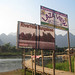 Signs to sunset bars, Vang Vieng