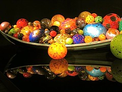 Chihuly blown glass artistry and reflections (ArtsySFMarjie) Tags: sf black chihuly art glass reflections de boat san francisco display circles background young balls exhibit dalechihuly blown noflashallowed 845pm 905twitterfacebooknotices 210b4twittr