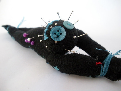 Tied Voodoo doll wrist-pincushion
