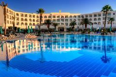 Welcome to paradise (renetka) Tags: blue sky reflection tree pool canon hotel tunisia sigma palm hammamet topaz 18200mm bazen photomatix 450d tunisko platinumheartaward
